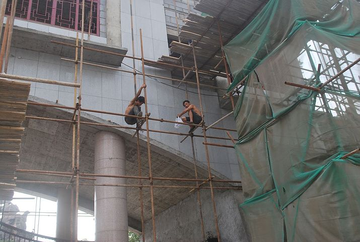 workers while on a scaffolding